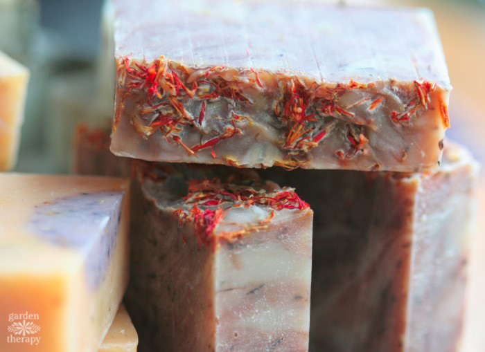 Bar of homemade soap topped with saffron