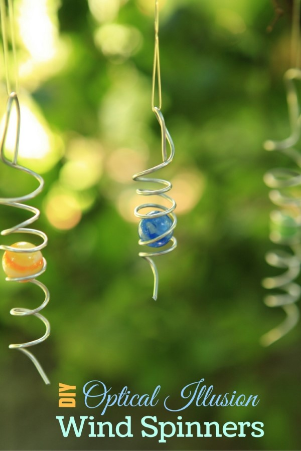 DIY optical illusion wind spinners made from wire and vintage marbles