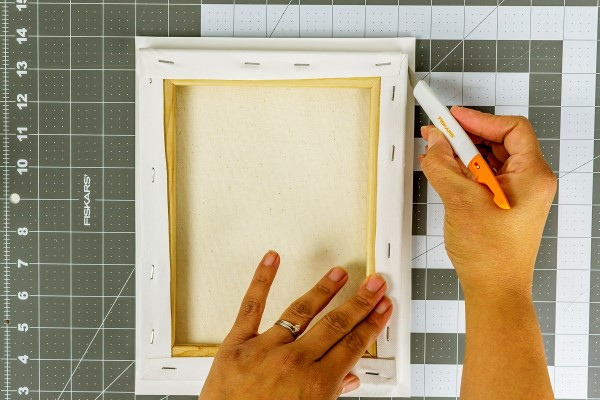 Trim excess paper with a craft knife