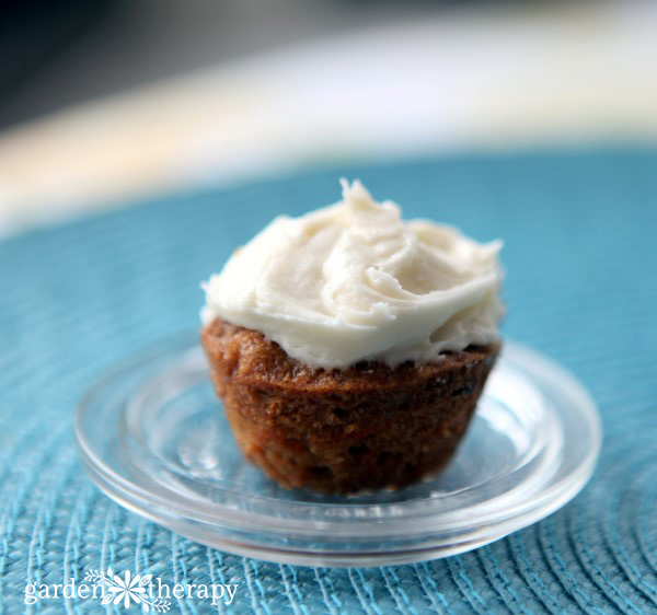 Mini whole wheat carrot cake cupcake topped with cream cheese frosting