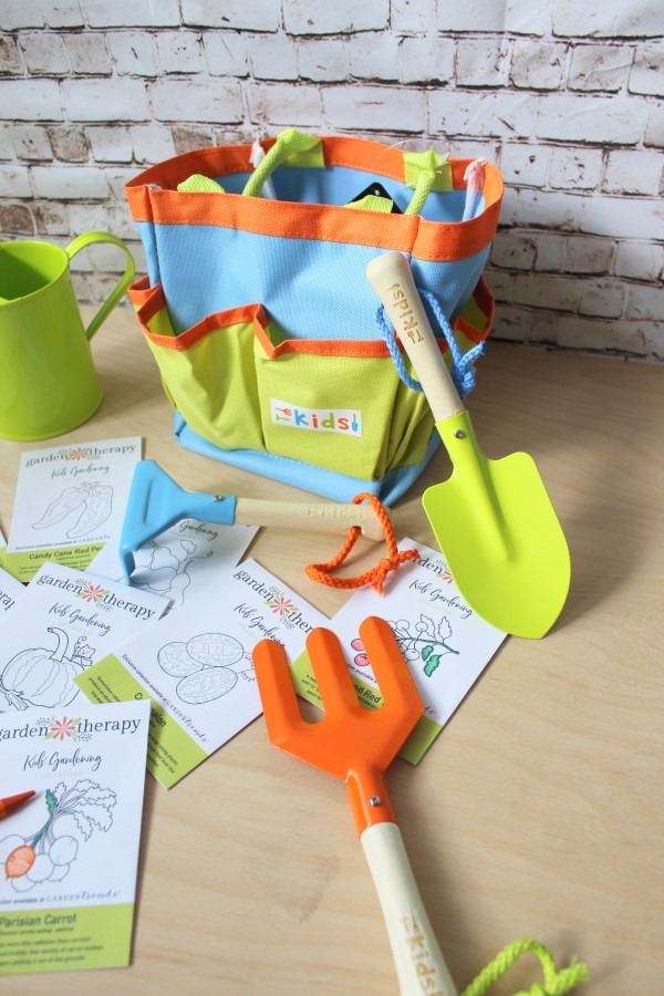 a colorful kids' garden tool set is included in this kit