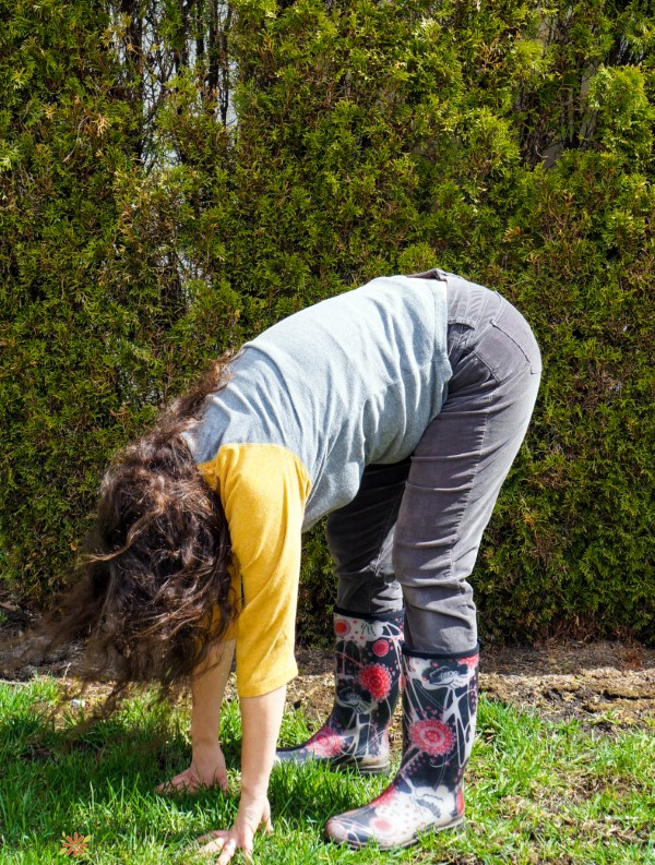 touch the earth: a stretch to prevent stiffness from gardening