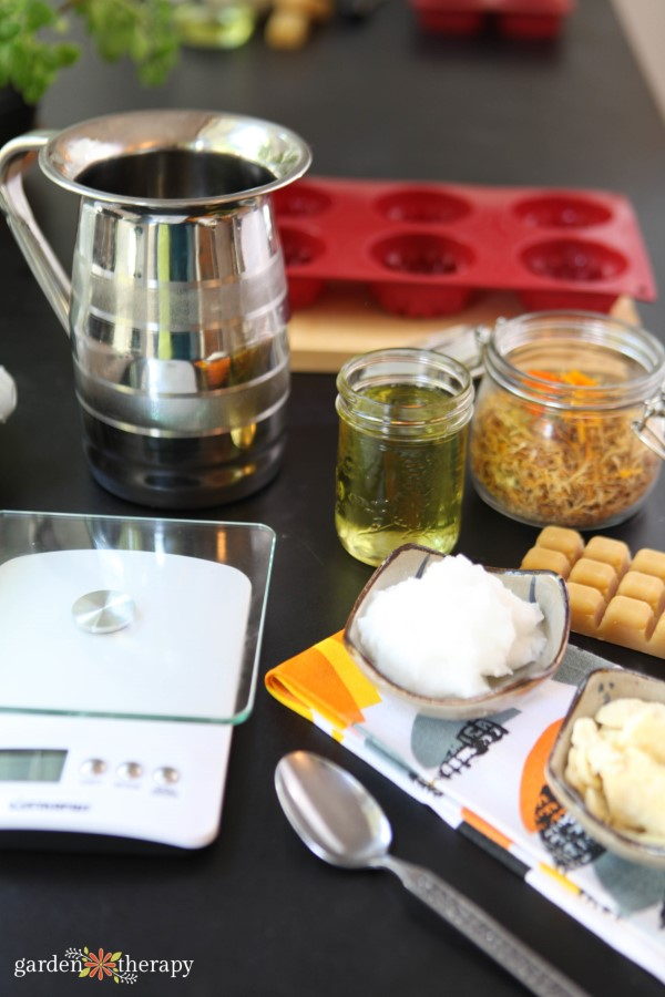 ingredients and materials for making calendula lotion bars