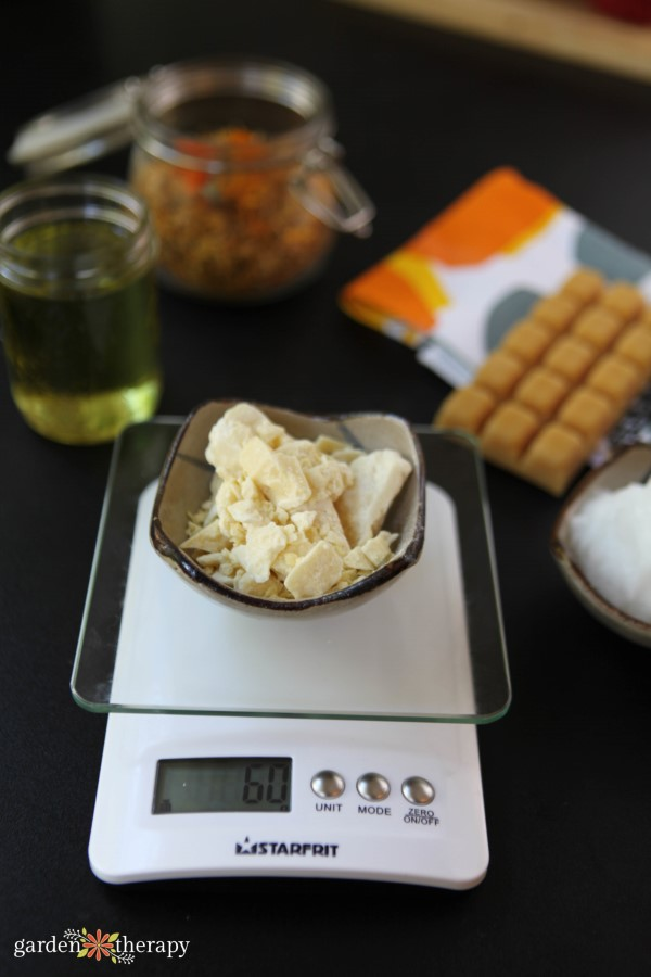 weighing ingredients for calendula summer lotion bars
