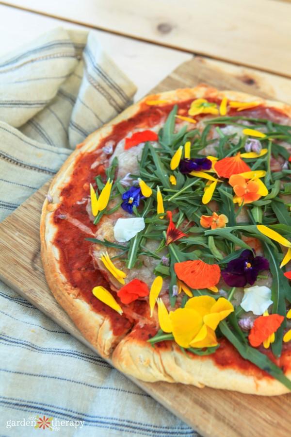 edible flower petals on pizza