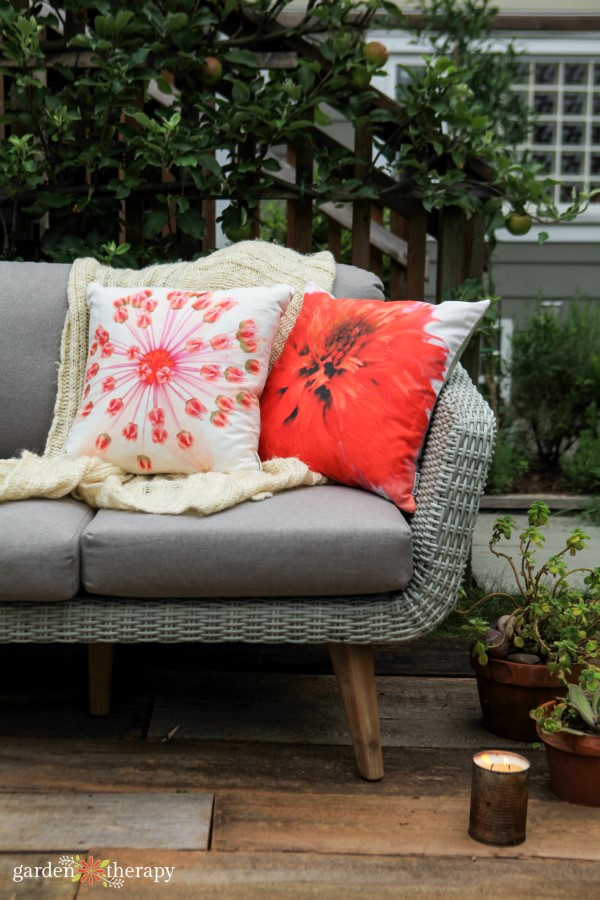 outdoor sofa with pillows and blanket