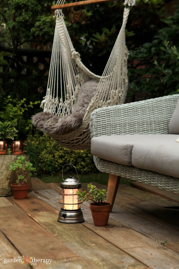 lantern and furniture in an outdoor living room