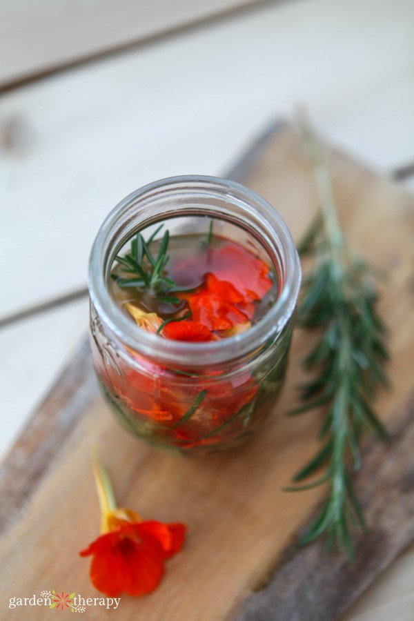 nastirtium and rosemary vinegar infusing in a jar