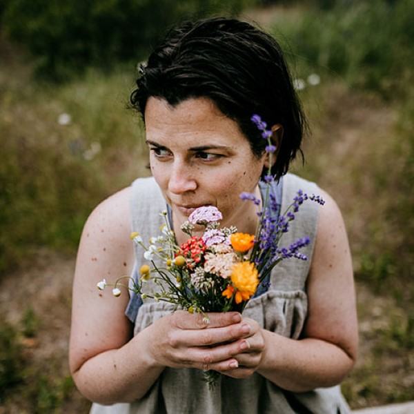 Colleen Codekas, author of Healing Herbal Infusions, holding a bunch of fresh flowers from her garden