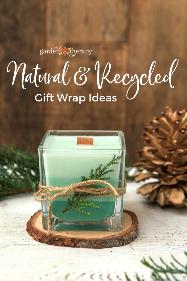 Gifted tri-green colored candle with evergreen decor and twine wrapped around