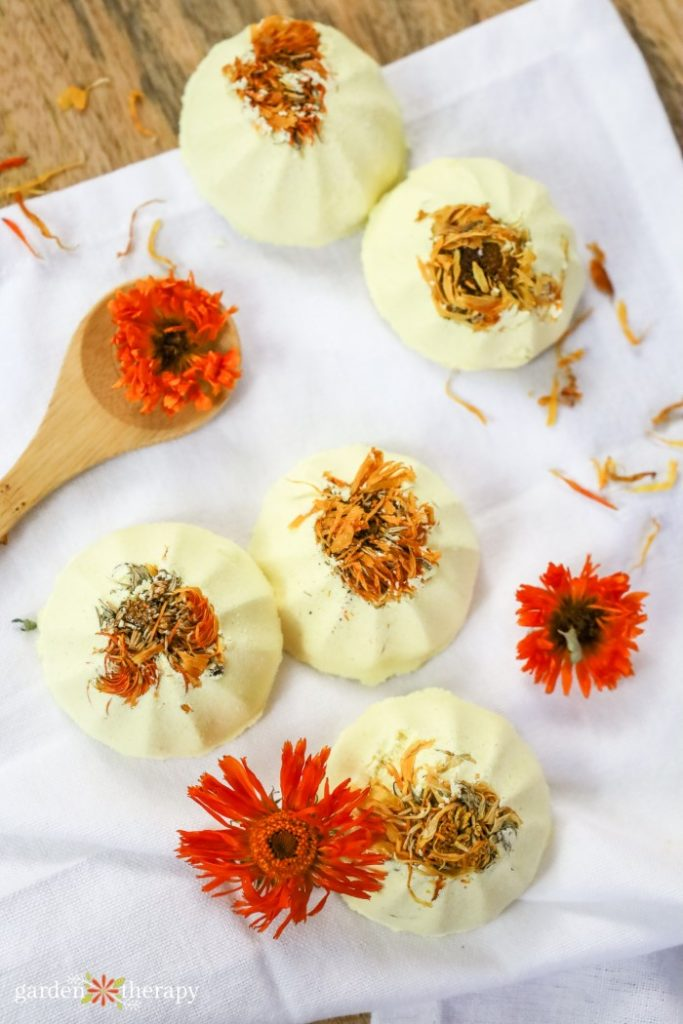 Shower steamers with dried flower petals on a white towel