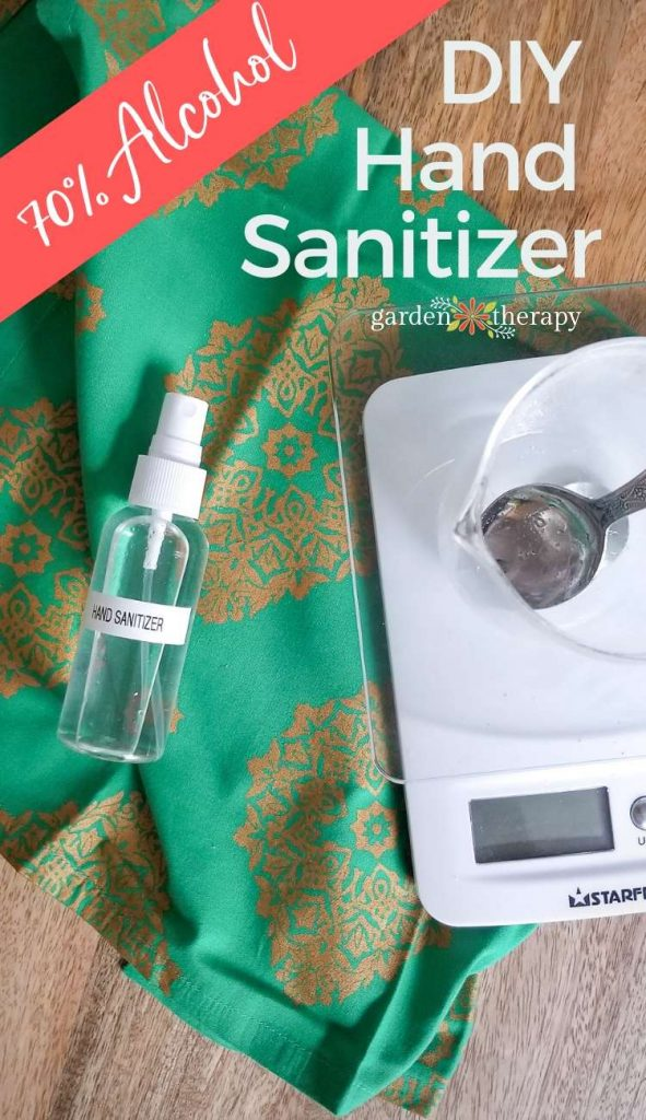DIY hand sanitizer in a spray bottle next to a scale