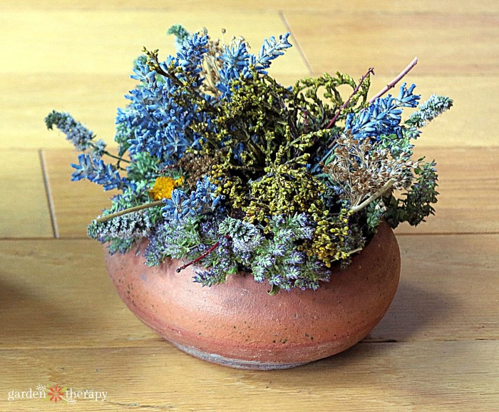 Dried oregano in a copper pot