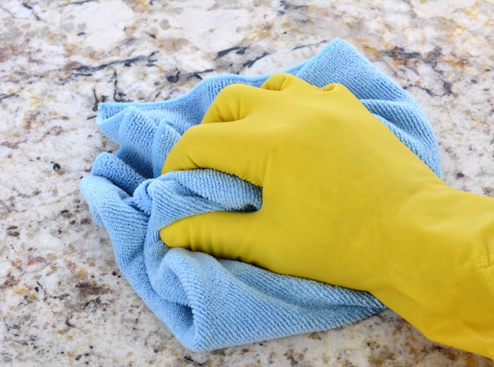 wiping granite countertop with a diy cleaner