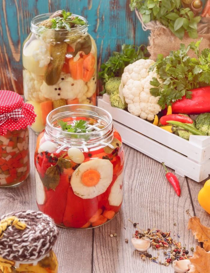 Various pickled veggies in open jars
