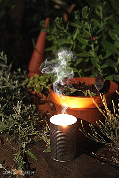 Citronella candle with smoke coming from it