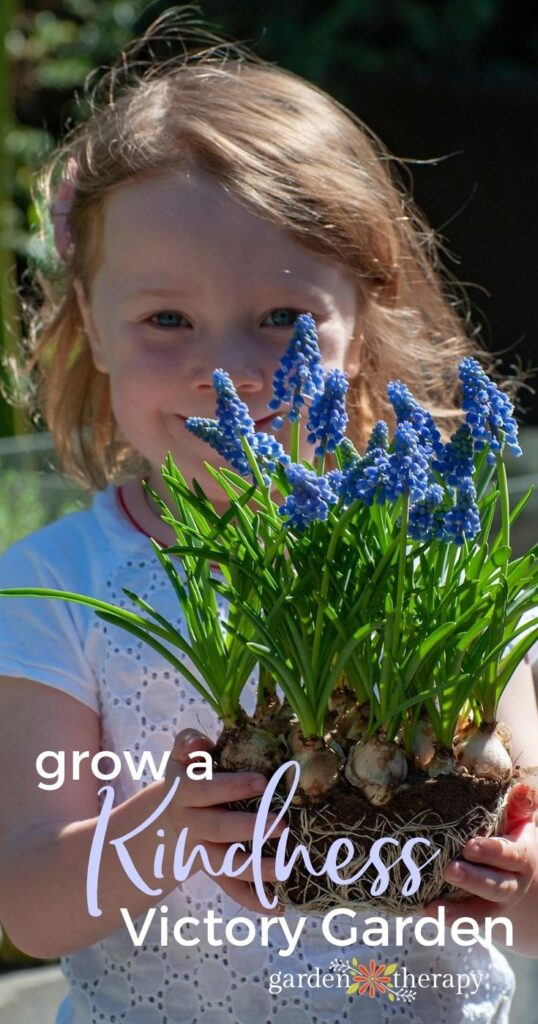 Young girl holding a bouquet of hyacinth flowers