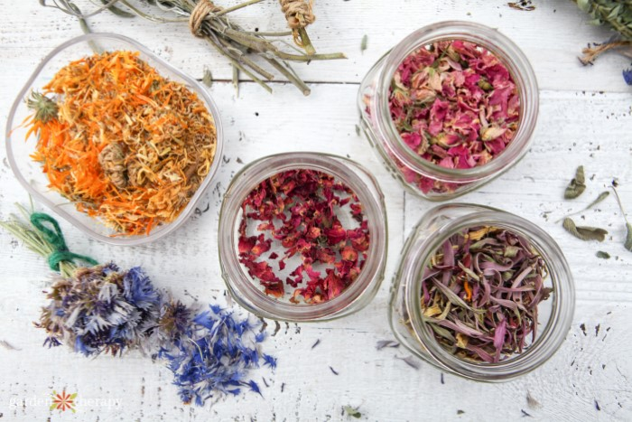 Dried flower petals in jars separated by color
