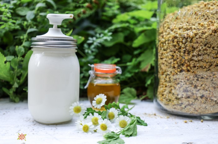 Magnesium lotion next to chamomile flowers