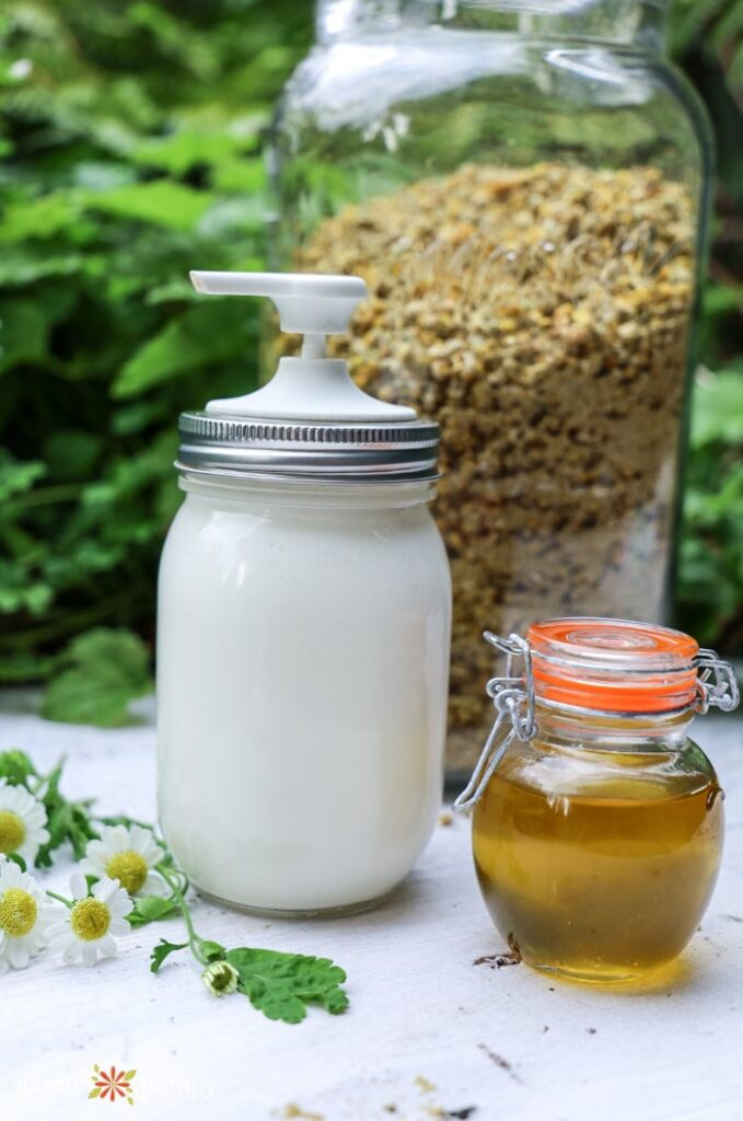 DIY magnesium lotion next to infused chamomile oil