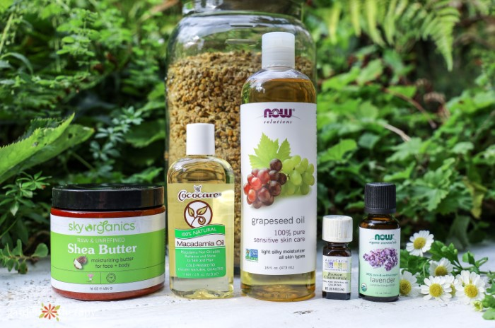 Suplies for DIY magnesium lotion including shea butter, grapeseed oil, macadamia oil, and essential oils