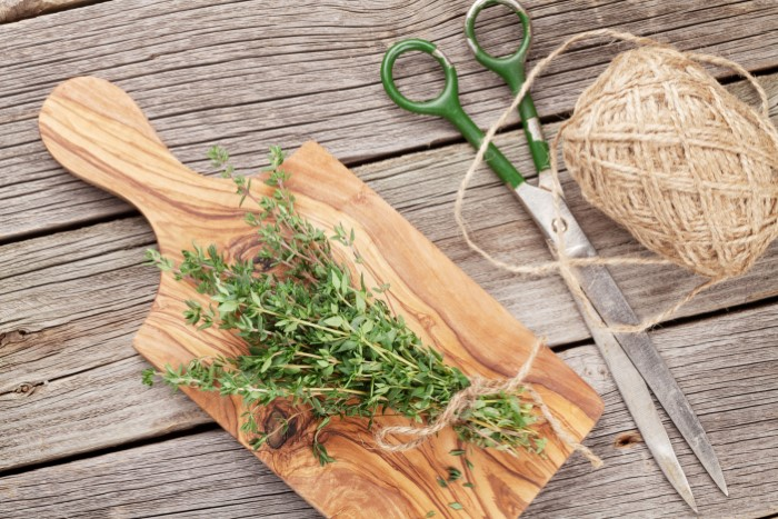 Bunch of garden thyme herb on wooden table