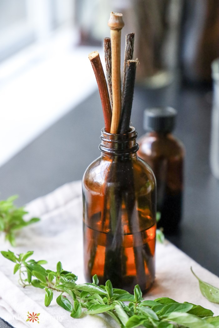 reed diffuser with fresh herbs