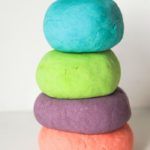 Stack of homemade scented playdough in bright colors