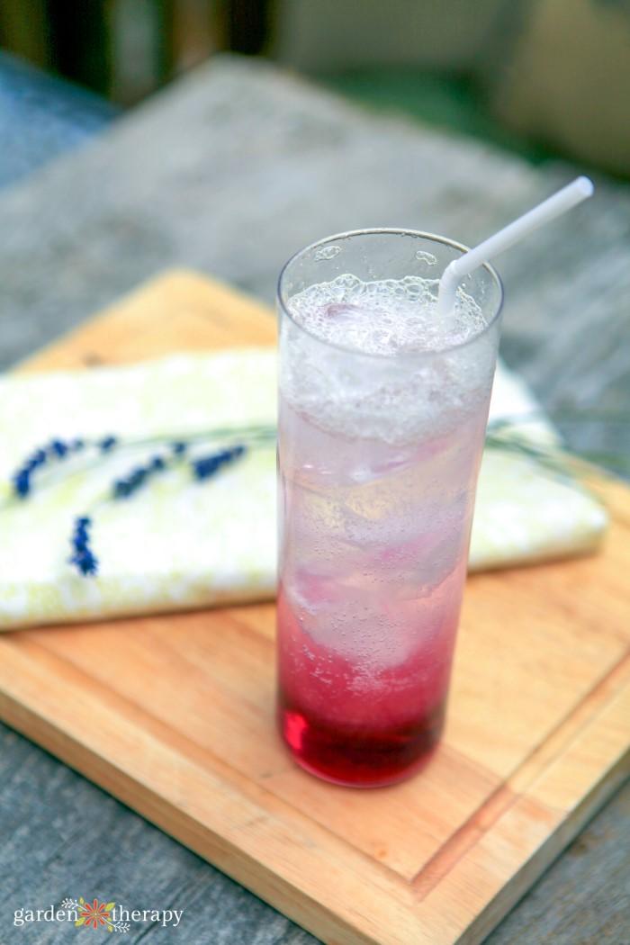 lavender lemonade drink on a wooden tray
