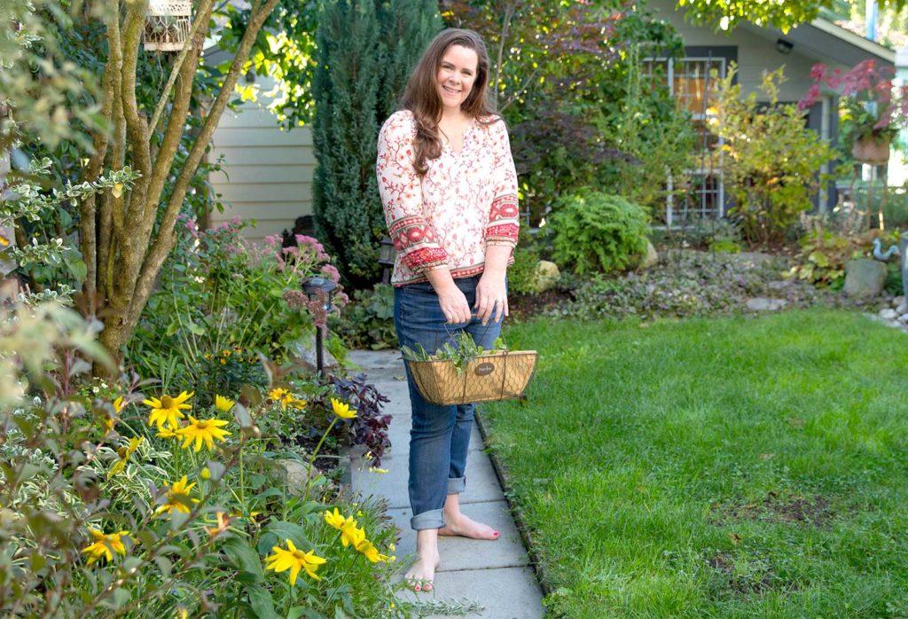 Stephanie standing in garden barefoot
