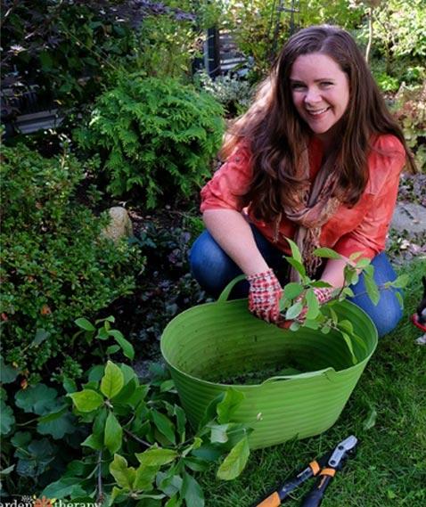 Stephanie in the garden gathering herbs