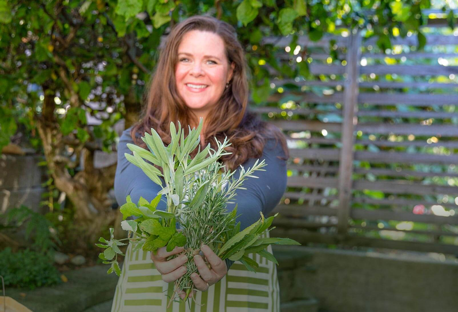 Stephanie Rose holding herbs